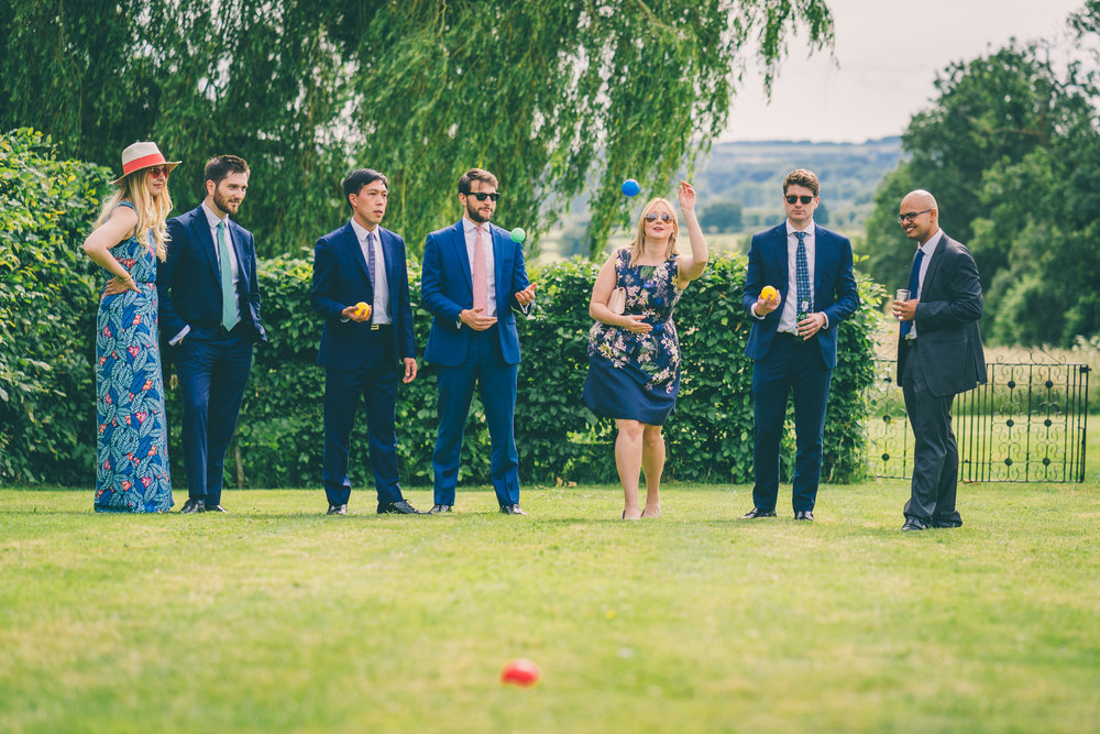 Relaxed cotswolds wedding_guest play boules on the lawn