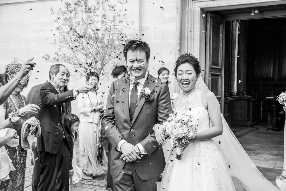 Oxford college wedding_confetti thrown over bride and groom