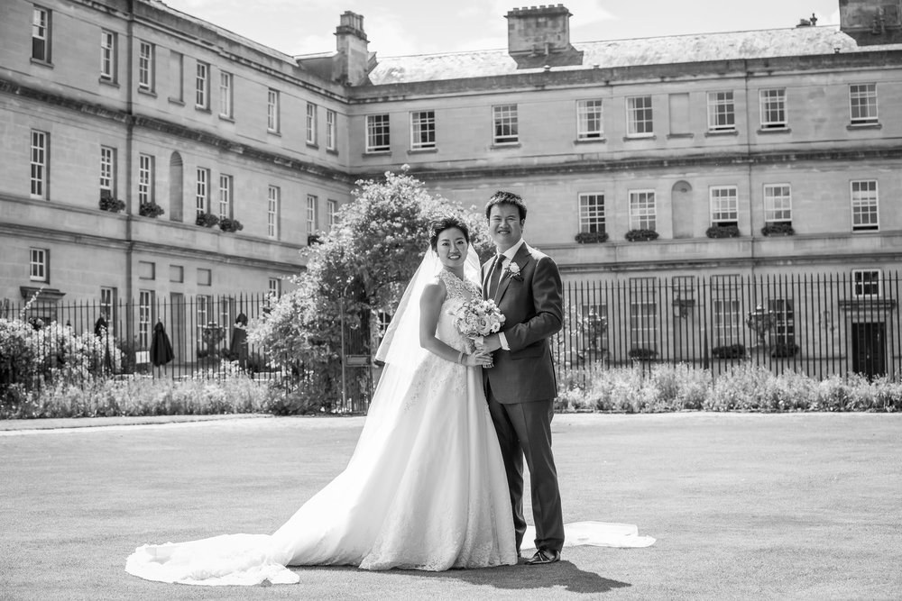Oxford college wedding_couple pose on Trinity College lawn