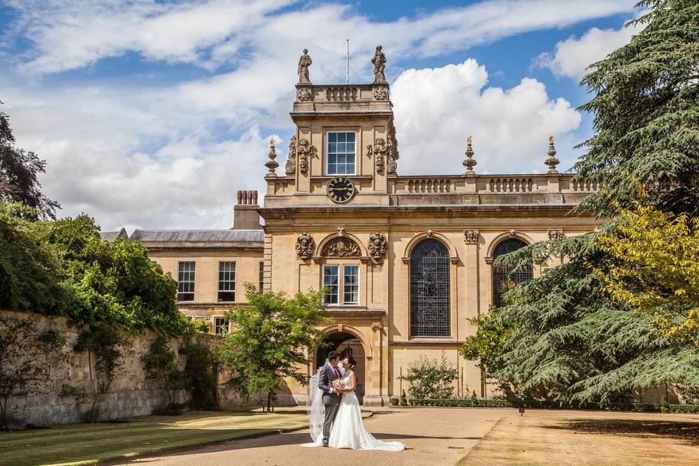 Oxford college wedding_couple pose outside Trinity College Oxford