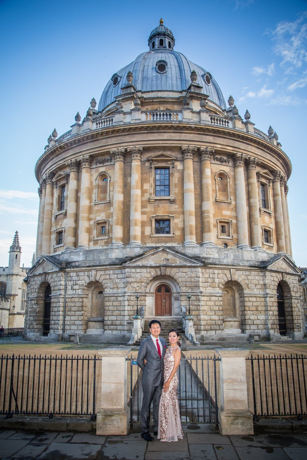 Oxford college wedding_couple pose outside Radcliffe Camera Oxford