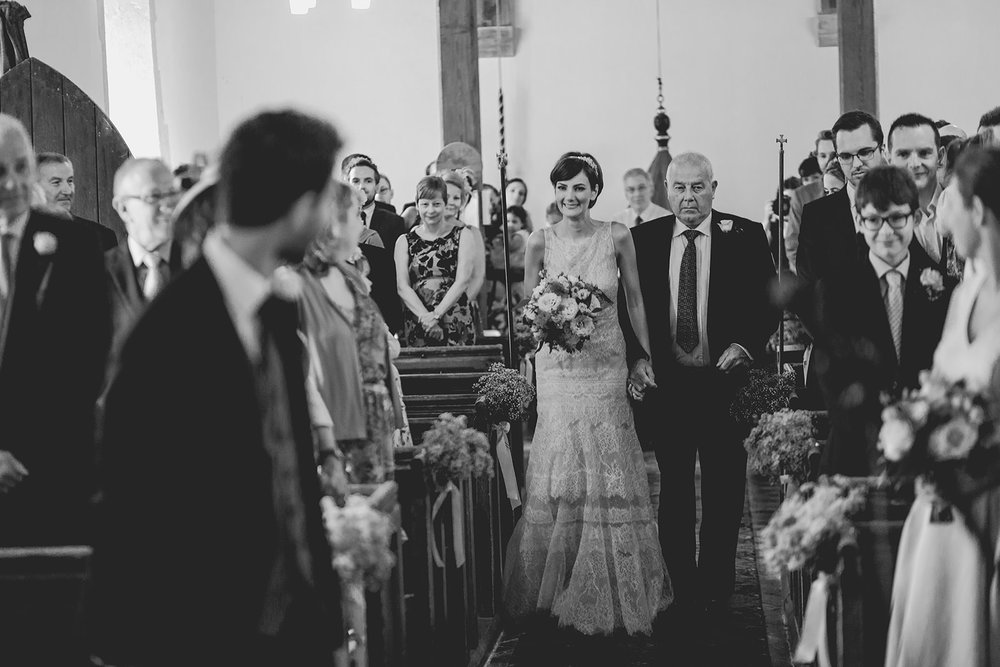 Eggington House marquee wedding_bride walks down aisle
