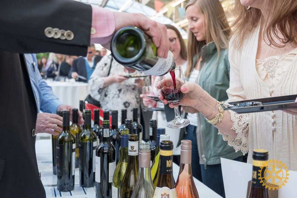 """On April 12th Rochester Rotary will be hosting their annual Wine & Beer Tasting Fundraiser at Bordine's Nursery from 6:30pm-8:30pm. The evening will include cuisine sampling from 20 local area restaurants, exclusive early access to Bordine's spring expo displays & sale, music by """"D&A Duo"""", Haig's of Rochester Jewelry auction, and a 50/50 raffle benefiting Neighborhood House."""