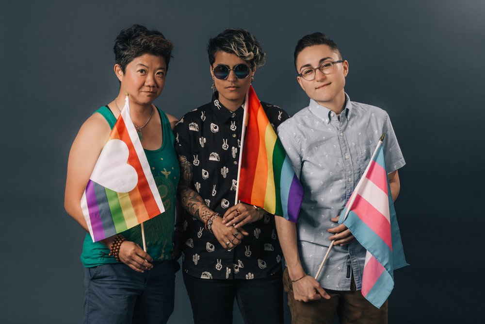 three-people-holding-pride-flags.jpg