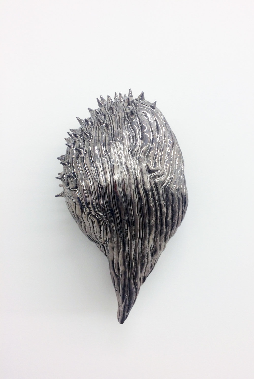 "Philippe Caron-Lefebvre, Chrome Therapy , 2017, ceramic, glaze, gold and white gloss,12.5"" x 7"" x 5"" (32 x 18 x 12 cm)."