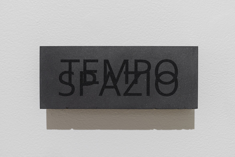 "Carl Trahan,  Tempo/Spazio , 2014, engraved graphite block,3"" x 8"" x 2"" (8 x 20 x 5 cm)."