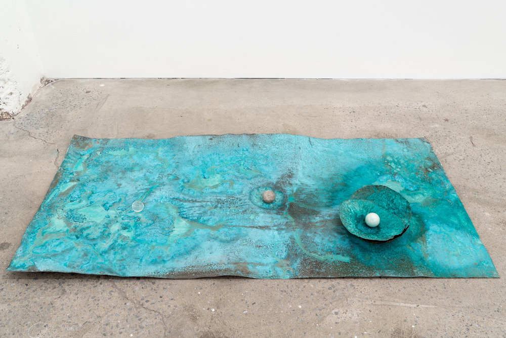 """Lorna Bauer,  The Toilers,  2018, hammered copper, miracle grow, crystal sphere, 24"""" x 48"""" (61 x 122 cm)"""
