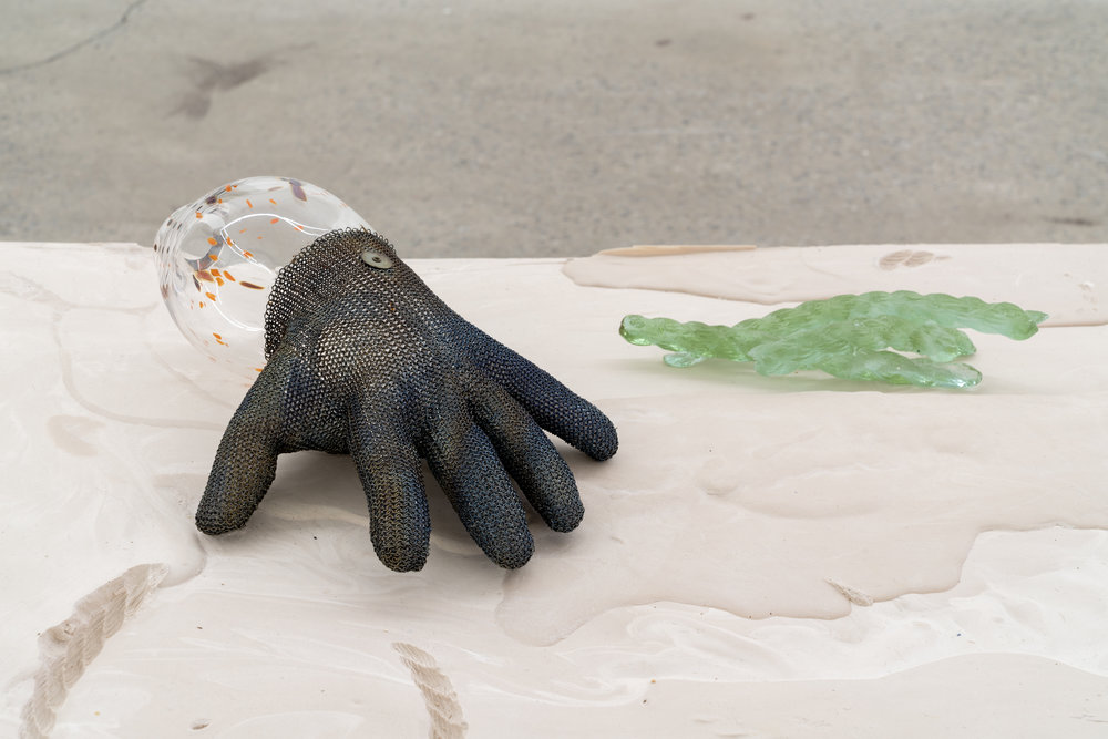 "Lorna Bauer,  The Hand of Mee and the Moonflower no.2 (detail),  2018, glown glass, butcher's glove, molded diachronic crystal, crystal sphere, plaster, wood, 20"" x 36"" x 84"" (51 x 91 x 213 cm)"