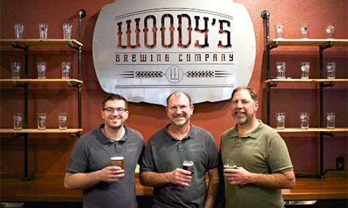 Andrew, Scott, and Pat Wlodarczyk at Woody's Brewing Company