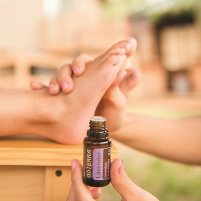 Topical use of doTERRA essential oils - in this case, applying essential oil to soles of feet