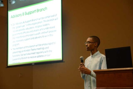 Chris Suggs, organizer of Kinston Teens and a freshman at Kinston High School, details his plans to allow teens the opportunity to collectively discuss change for the city on Tuesday at the Kinston Lenoir Public Library. - Photo by Janet S. Carter/The Free Press