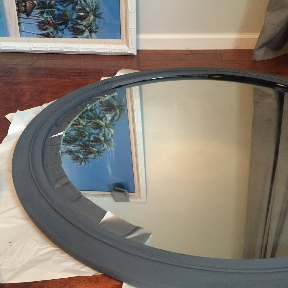 A little duct tape around around the edges of the mirror helped to keep the paint on the frame and off the glass.