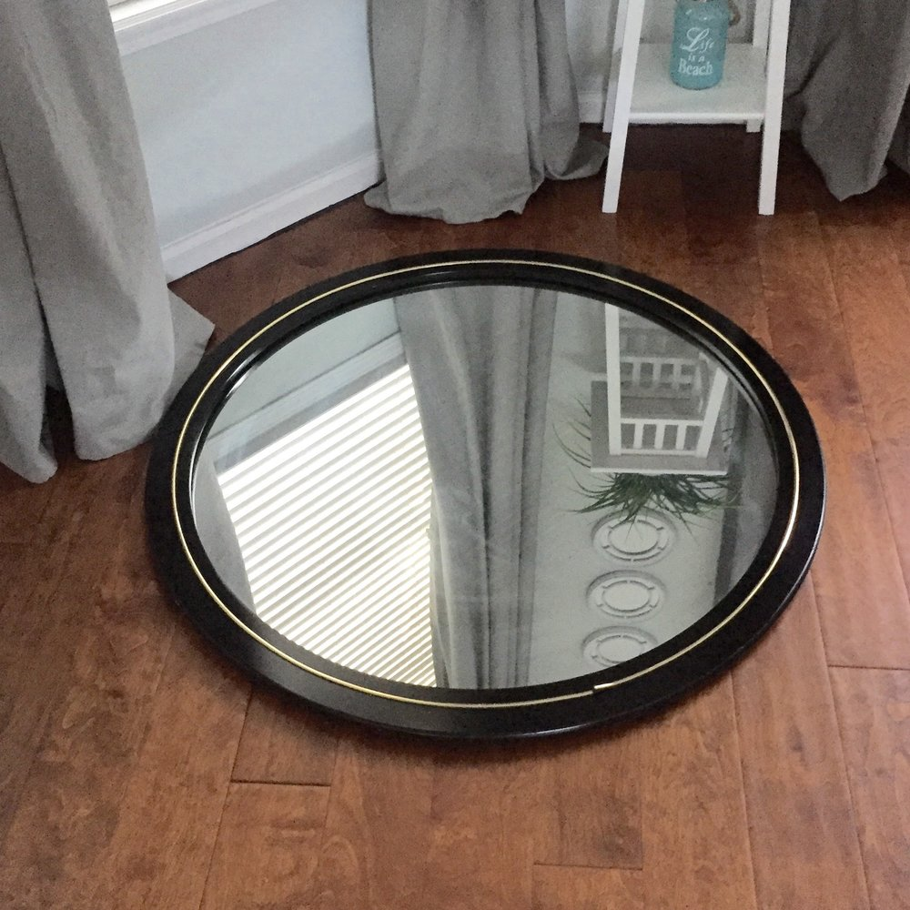 The perfect mirror, in its original, hideous, black and gold form.