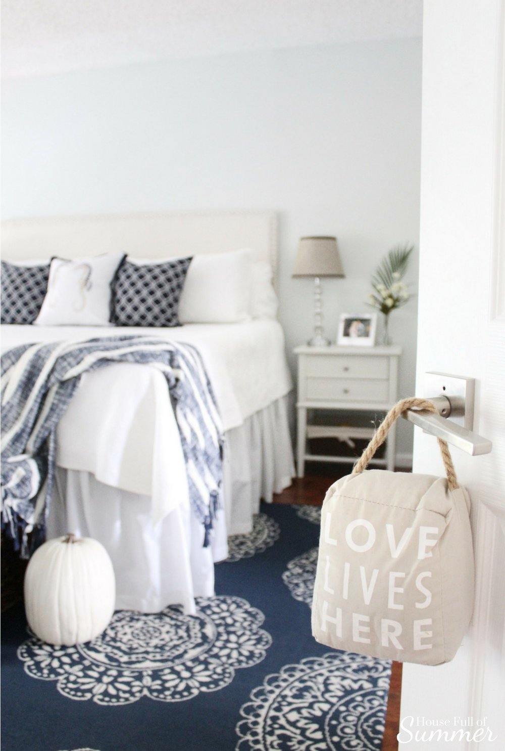 House Full of Summer: Fall Home Tour Blog Hop - Cozy, Coastal, Chic  Master Bedroom decor, navy and white, indoor/outdoor rug, cheap rugs, decorating on a budget, white bedding, fall decor ideas, white pumpkins, coastal bedroom ideas