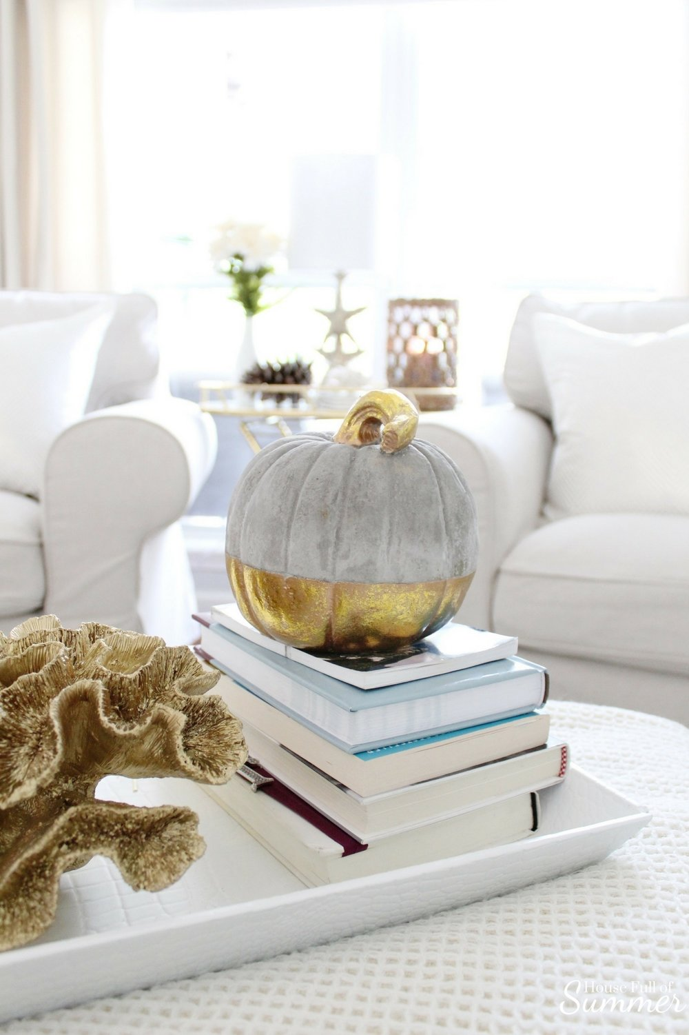 House Full of Summer: Fall Home Tour Blog Hop - Cozy, Coastal, Chic Living Room fall decorating ideas. Neutral interior, living room decor, gold dipped pumpkin, gold coral, living room ideas, sitting room, wood floors, table styling, pine cones, gold accents, home goods