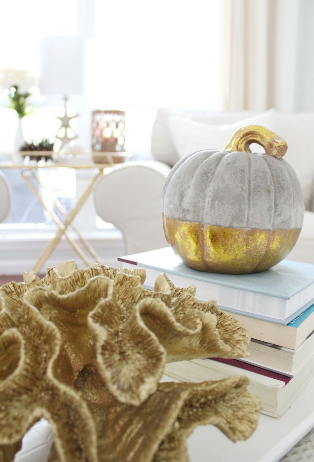 House Full of Summer: Fall Home Tour Blog Hop - Cozy, Coastal, Chic Living Room fall decorating ideas. Neutral interior, living room decor, gold dipped pumpkin, gold coral, living room ideas,
