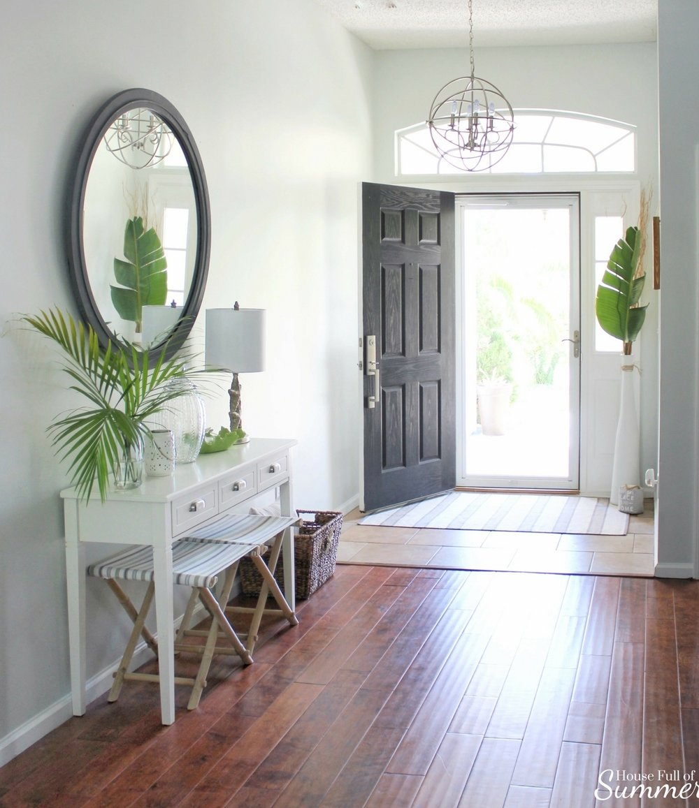 House Full of Summer - Foyer makeover on a budget, before and after, white console table, entryway decor, foyer ideas, stools, tropical home style, coastal decor, large round mirror, diy