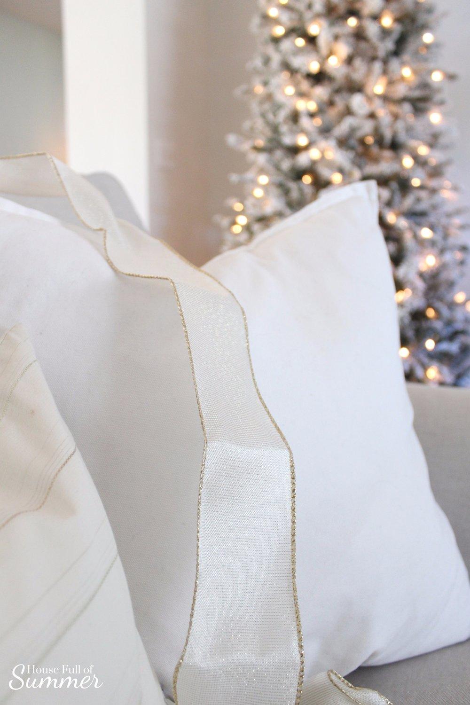Simple DIY Christmas Present Throw Pillow | House Full of Summer blog - holidays, christmas decor ideas, coastal christmas, white christmas decor, glam christmas, gold and white christmas decor, ribbon, coastal chic christmas, quick and easy decorating tips