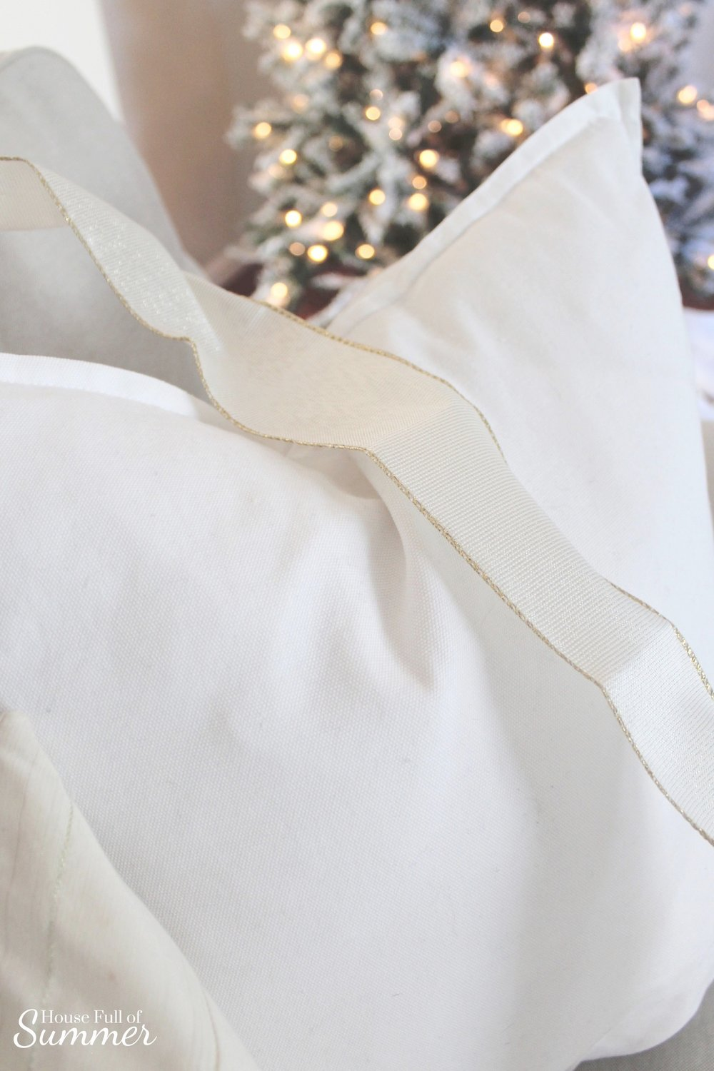 Simple DIY Christmas Present Throw Pillow | House Full of Summer blog - holidays, christmas decor ideas, coastal christmas, white christmas decor, glam christmas, gold and white christmas decor, ribbon, coastal chic christmas, quick and easy decorating tips