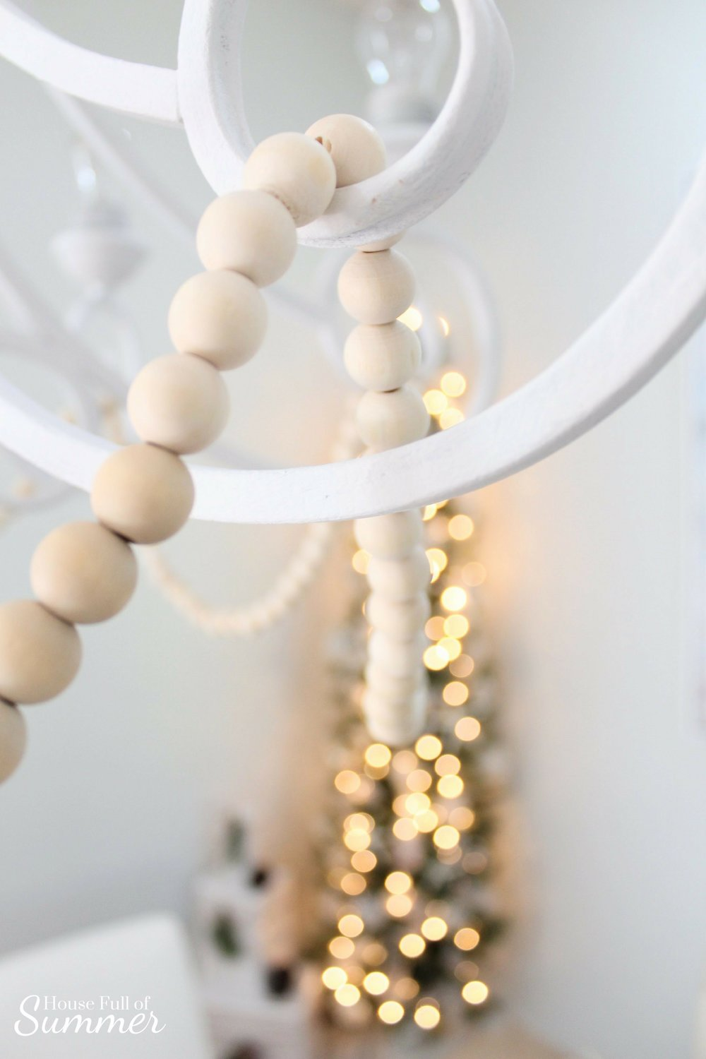Christmas Home Tour | House Full of Summer blog hop - Cheerful Christmas Home Tour coastal christmas neutral christmas decor, holiday home tour, florida christmas, dining room, chandelier, painted, wooden beaded chandelier, twinkling lights, fairy lights,