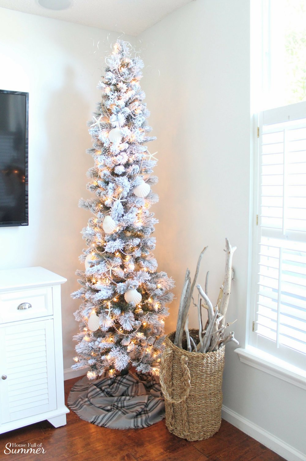 Classy Christmas Home Tour {Part Two} | House Full of Summer blog - flocked pencil tree, coastal christmas tree decorations, seashell garland, beaded garland