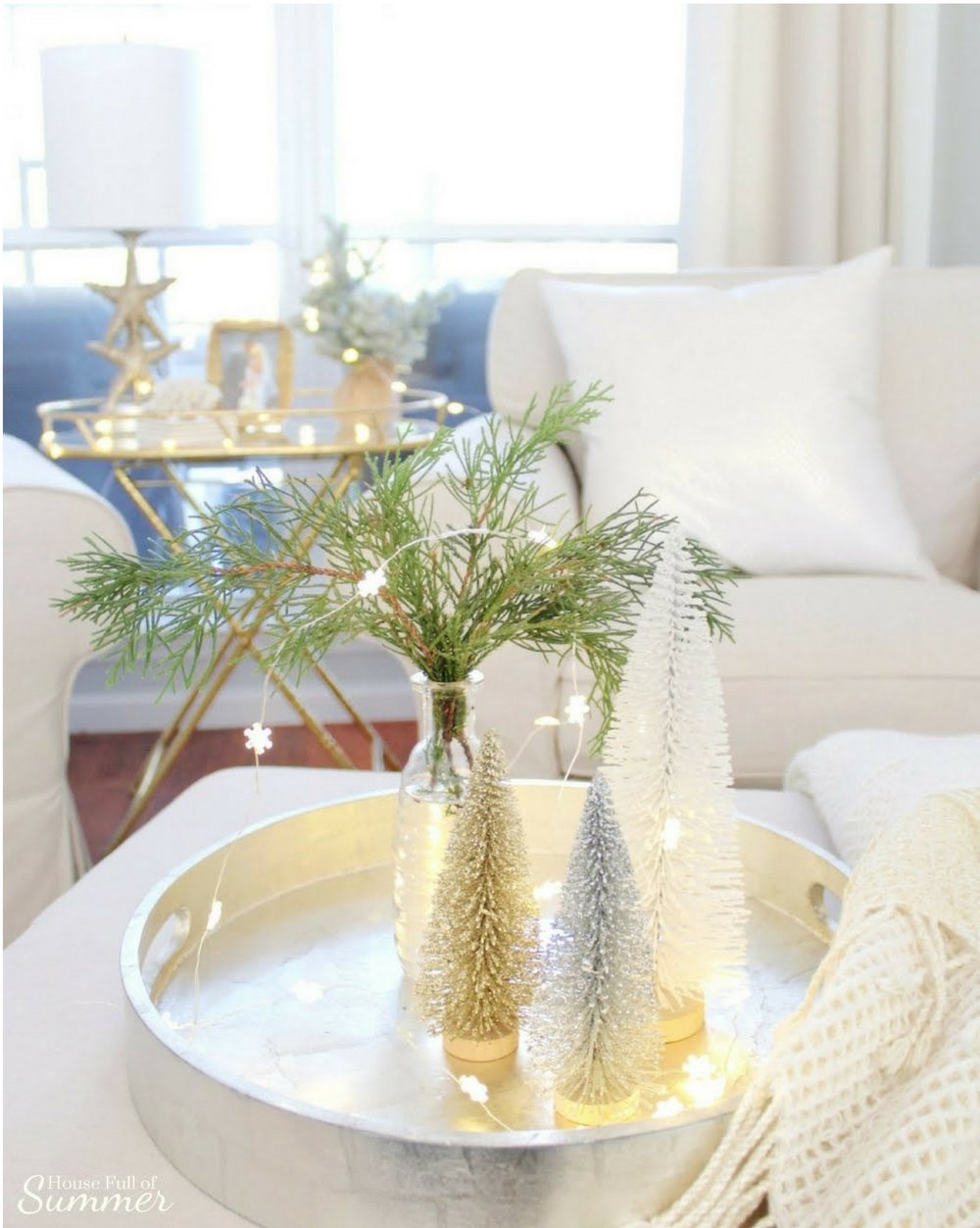 Add New Life to Your Home With This New Year's Resolution | House Full of Summer blog adding greenery to your home, decorating with plants, fronds, trimmings, winter decor, home decor, coastal home interior, capiz chandelier, decor on a budget, neutral winter decor ideas, coastal winter decor, bottle brush trees, fairy lights living room