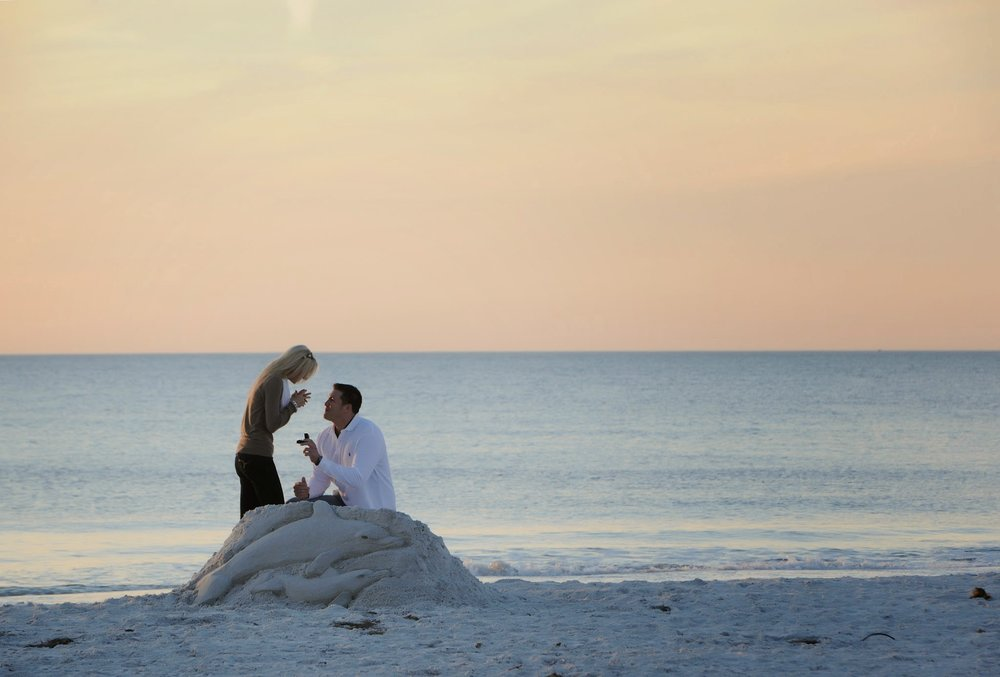 The Pink Palace Proposal | House Full of Summer - A romantic beach proposal at the Don CeSar on St. Pete Beach, Florida,  sand sculpture proposal, beach engagement, sunset proposal on the beach, secret photographer, how he asked, best wedding proposal, creative proposal
