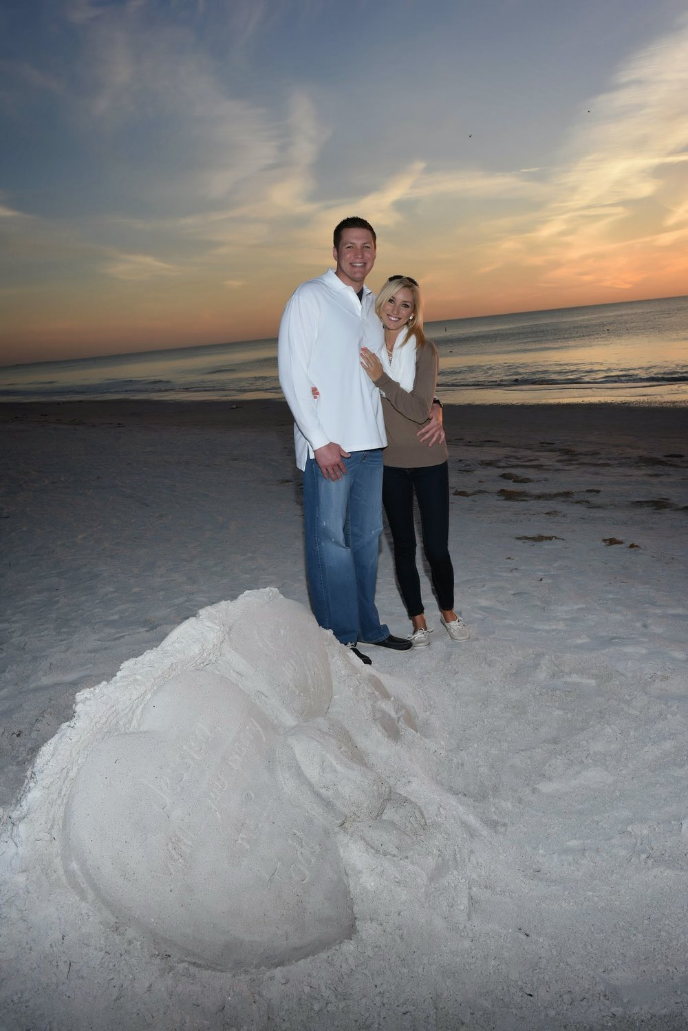 The Pink Palace Proposal | House Full of Summer - A romantic beach proposal at the Don CeSar on St. Pete Beach, Florida,  sand sculpture proposal, beach engagement, sunset proposal on the beach, secret photographerhow he asked, best wedding proposal, creative proposal , must love dogs, dog wedding proposal how he asked, best wedding proposal, creative proposal , must love dogs, dog wedding proposal