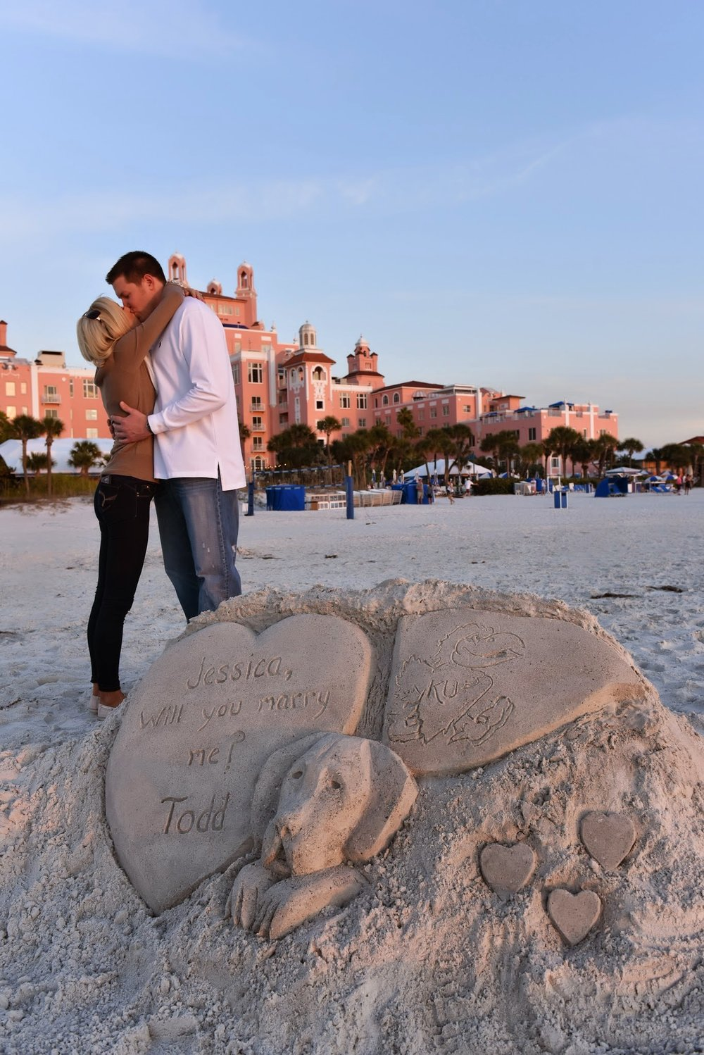 The Pink Palace Proposal | House Full of Summer - A romantic beach proposal at the Don CeSar on St. Pete Beach, Florida,  sand sculpture proposal, beach engagement, sunset proposal on the beach, secret photographerhow he asked, best wedding proposal, creative proposal , must love dogs, dog wedding proposal
