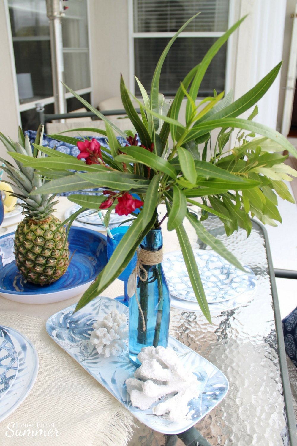 Blue Palms & Pineapples Outdoor Tablescape | House Full of Summer partnership with Christmas Tree Shops andThat! Coastal Living line, outdoor entertaining, poolside dining, plasticware, melamine, tropical dishes, chinoiserie chic, patio decor, coastal tablescape, blue and white table setting, pineapple cocktail, plastic blue wine glasses, navy and white decor, Florida home living, using backyard plants as fresh greenery #ad #Christmastreeshops