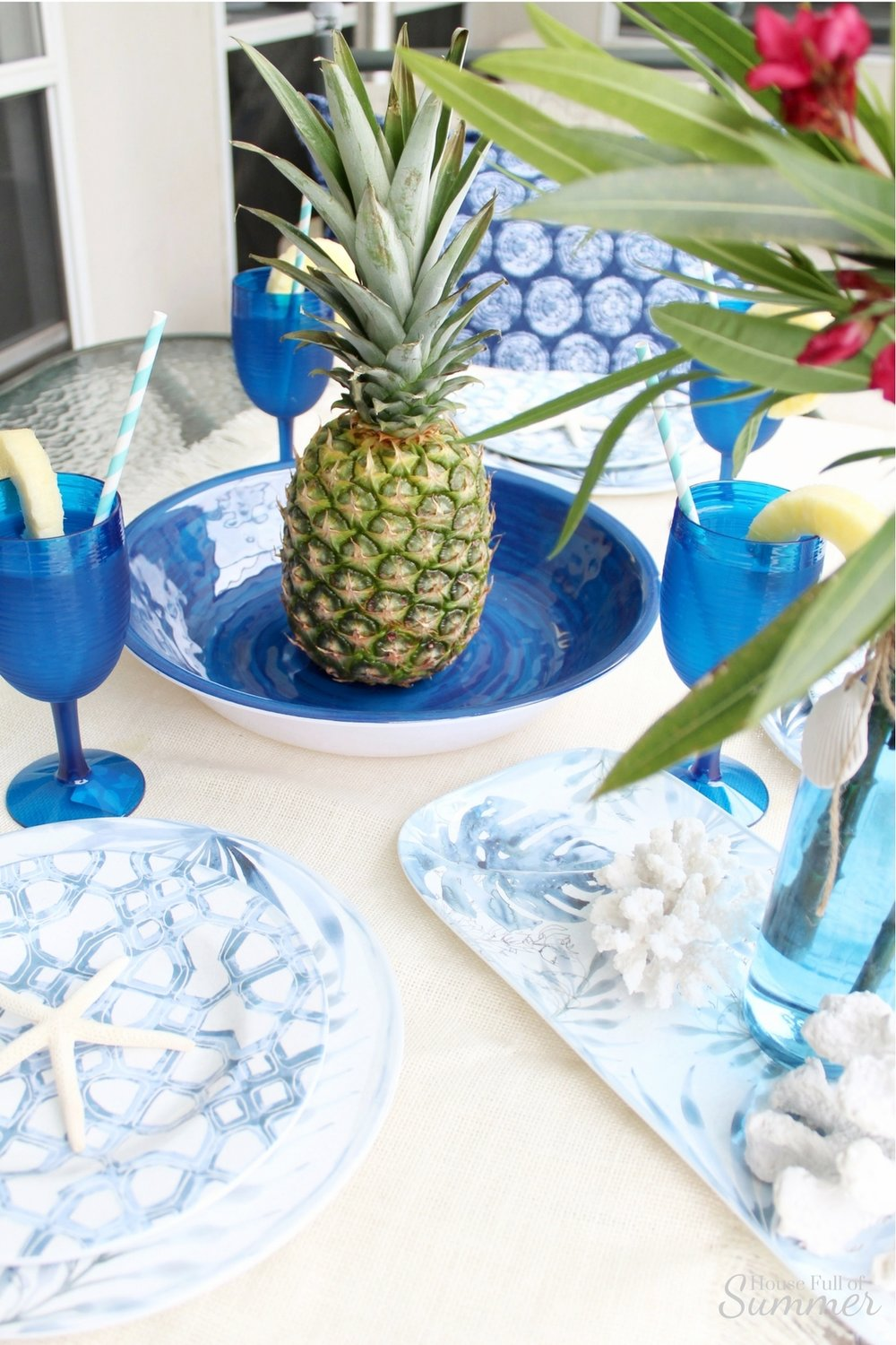Blue Palms & Pineapples Outdoor Tablescape | House Full of Summer partnership with Christmas Tree Shops andThat! Coastal Living line, outdoor entertaining, poolside dining, plasticware, melamine, tropical dishes, chinoiserie chic, patio decor, coastal tablescape, blue and white table setting, pineapple cocktail, plastic blue wine glasses, navy and white decor, Florida home living #ad #Christmastreeshops