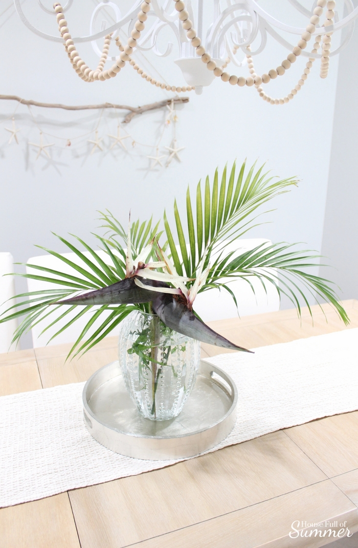 Loveliest Looks of Summer Tour | Fresh & Breezy Summer Style - coastal home decor for summertime, summer outfit ideas, ruffle top, tassel earrings, living room decor, dining room decor, tropical greenery, decor on a budget, free ways to decorate, foyer styling, giant bird of paradise, beaded chandelier diy