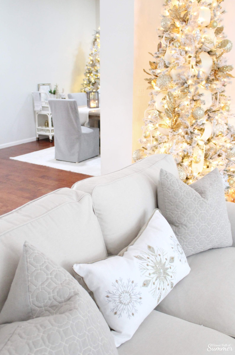 A Charming Southern Christmas Home Tour {Part 1} | House Full of Summer - Gold Magnolias and Southern influences in Christmas decor, neutral Christmas decorating, foyer, living room, Christmas centerpiece, greenery, DIY holiday arrangement, coastal decor, Southern Christmas tree ornament ideas tassel ornaments