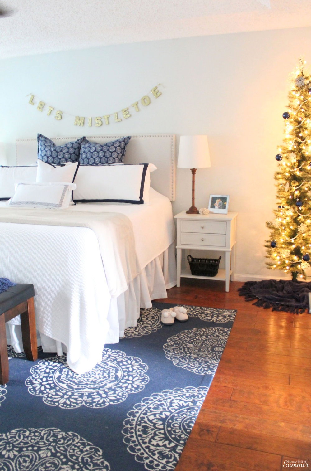 A Charming Southern Christmas Home Tour {Part 2} | House Full of Summer - Master Bedroom Christmas decor ideas, navy Christmas decorations, blue and white holiday decor, foyer, Gold Magnolias and Southern influences in Christmas decor, neutral Christmas decorating, foyer, living room, Christmas centerpiece, greenery, DIY holiday arrangement, coastal decor, Southern Christmas tree ornament ideas tassel ornaments, Christmas garland, bedroom Christmas Tree
