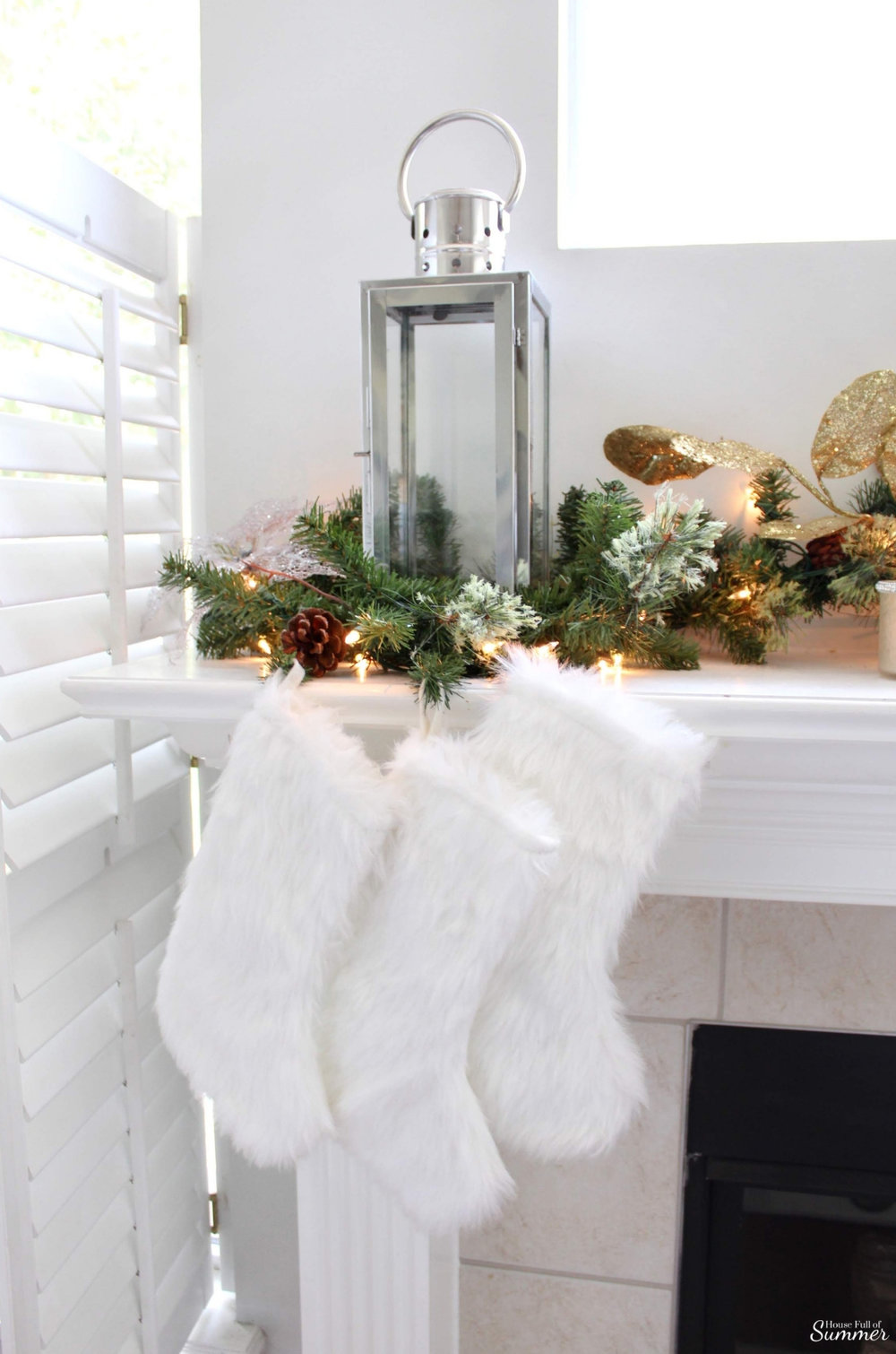 A Charming Southern Christmas Home Tour {Part 2} | House Full of Summer - Master Bedroom Christmas decor ideas, navy Christmas decorations, blue and white holiday decor, foyer, Gold Magnolias and Southern influences in Christmas decor, neutral Christmas decorating, foyer, living room, Christmas centerpiece, greenery, DIY holiday arrangement, coastal decor, Southern Christmas tree ornament ideas tassel ornaments mantle decor