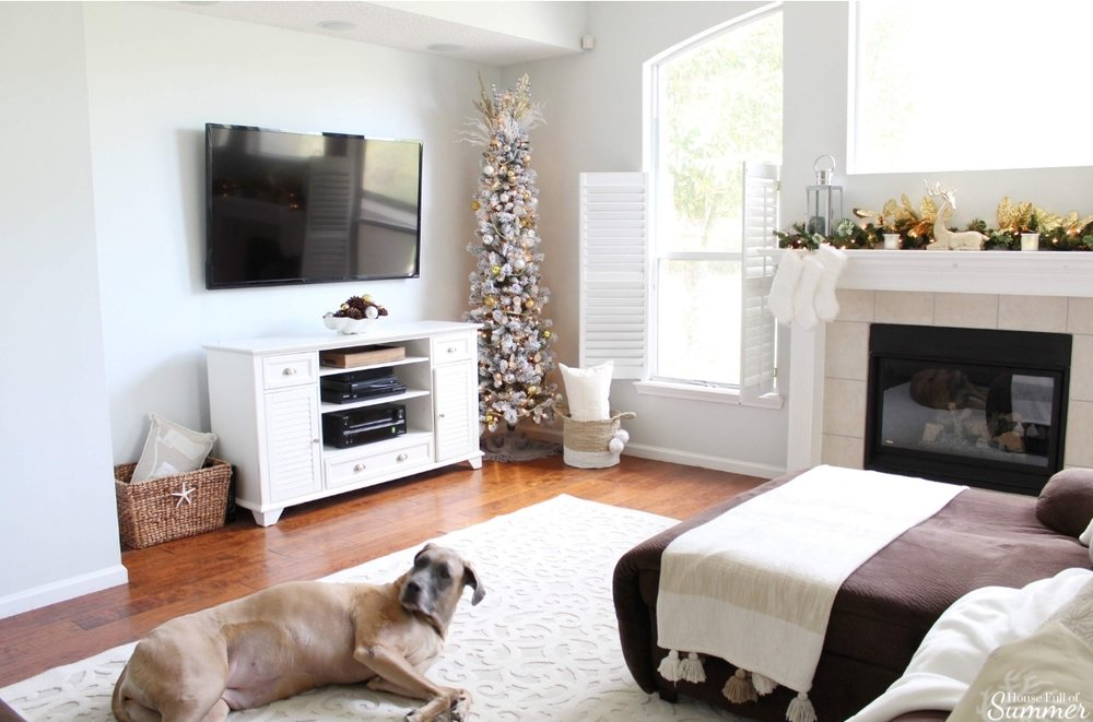 A Charming Southern Christmas Home Tour {Part 2} | House Full of Summer - Master Bedroom Christmas decor ideas, navy Christmas decorations, blue and white holiday decor, foyer, Gold Magnolias and Southern influences in Christmas decor, neutral Christmas decorating, foyer, living room, Christmas centerpiece, greenery, DIY holiday arrangement, coastal decor, Southern Christmas tree ornament ideas tassel ornaments, family room, white rug, durable rugs for dogs