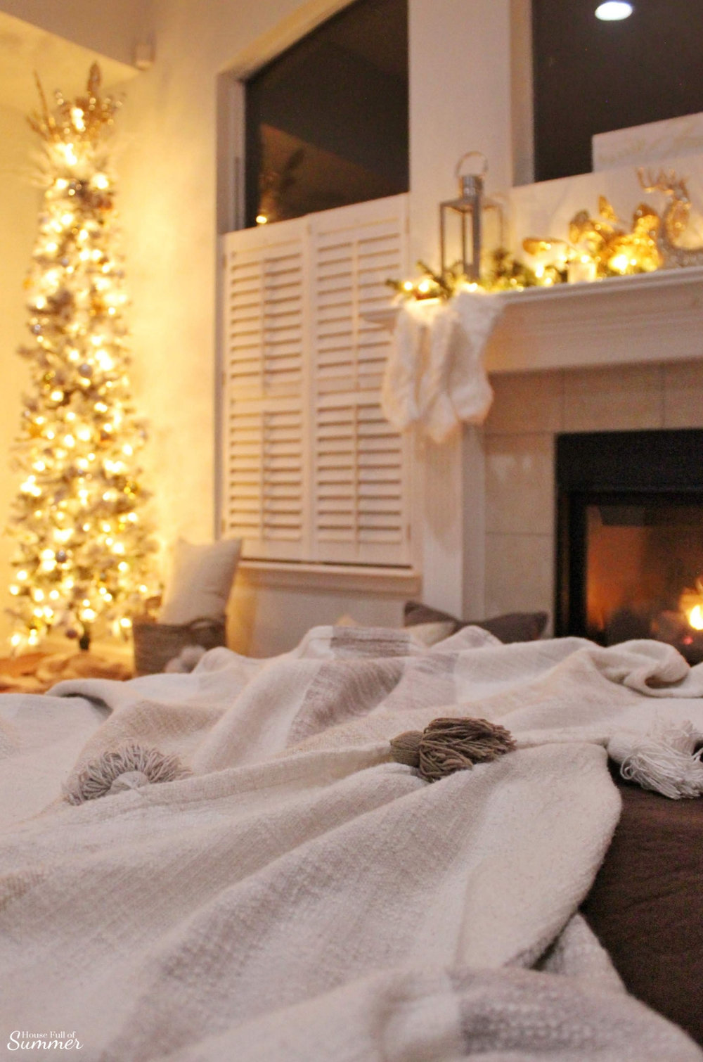 Cozy Christmas Nights by the Fire | white area rug, mantel decor, gold glam decor, pencil christmas tree, plantation shutters, Southern home charm, Coastal Christmas decor, Christmas in Florida, family room, living room, dog friendly, House Full of Summer