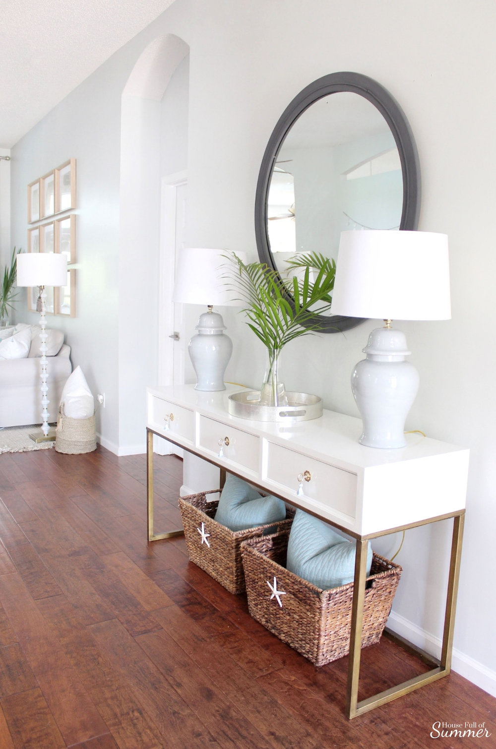 Adding Spring Color to the Living Room and Foyer | House Full of Summer - spring decor, coastal decor, neutral interior, turquoise accents, console table, round mirror, fiddle leaf fig, decorating with palm fronds, entryway, lighting, Florida home decor ideas, slip covered furniture, jute rug, beach house style, cane bar cart, DIY spray paint, budget decor, rattan bar cart, bamboo cart, accent table, spring home tour