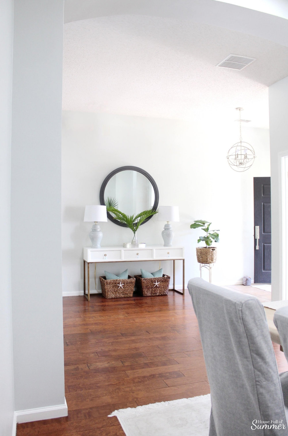 Adding Spring Color to the Living Room and Foyer | House Full of Summer - spring decor, coastal decor, neutral interior, turquoise accents, console table, round mirror, fiddle leaf fig, decorating with palm fronds, entryway, lighting, Florida home decor ideas, slip covered furniture, jute rug, beach house style, cane bar cart, DIY spray paint, budget decor, rattan bar cart, bamboo cart, accent table, spring home tour, chinoiserie chic