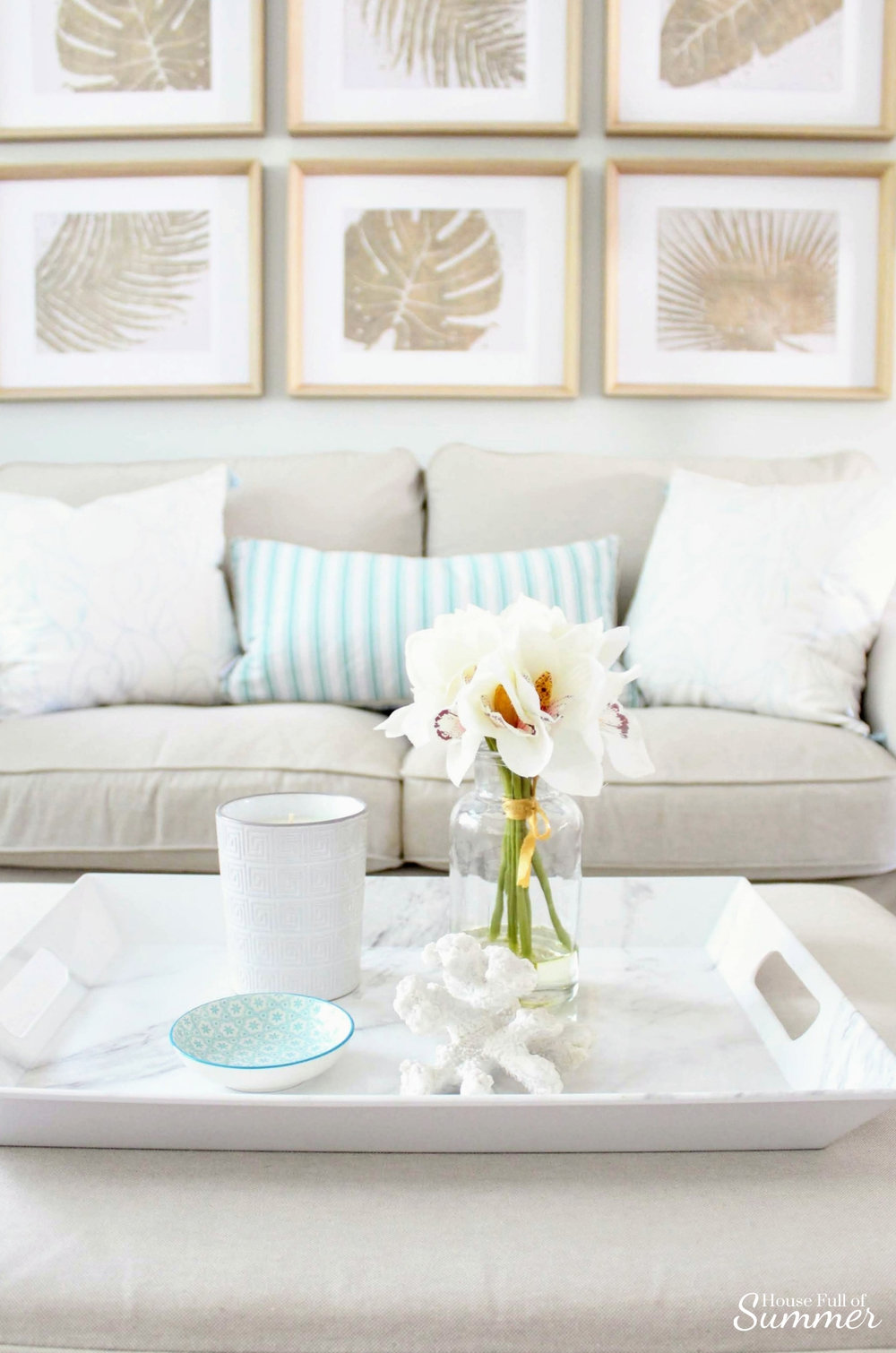 Adding Spring Color to the Living Room and Foyer | House Full of Summer - spring decor, coastal decor, neutral interior, turquoise accents, console table, round mirror, fiddle leaf fig, decorating with palm fronds, entryway, lighting, Florida home decor ideas, slip covered furniture, jute rug, beach house style, cane bar cart, DIY spray paint, budget decor, rattan bar cart, bamboo cart, accent table, spring home tour, chinoiserie chic, coffee table styling, ottoman, gallery wall