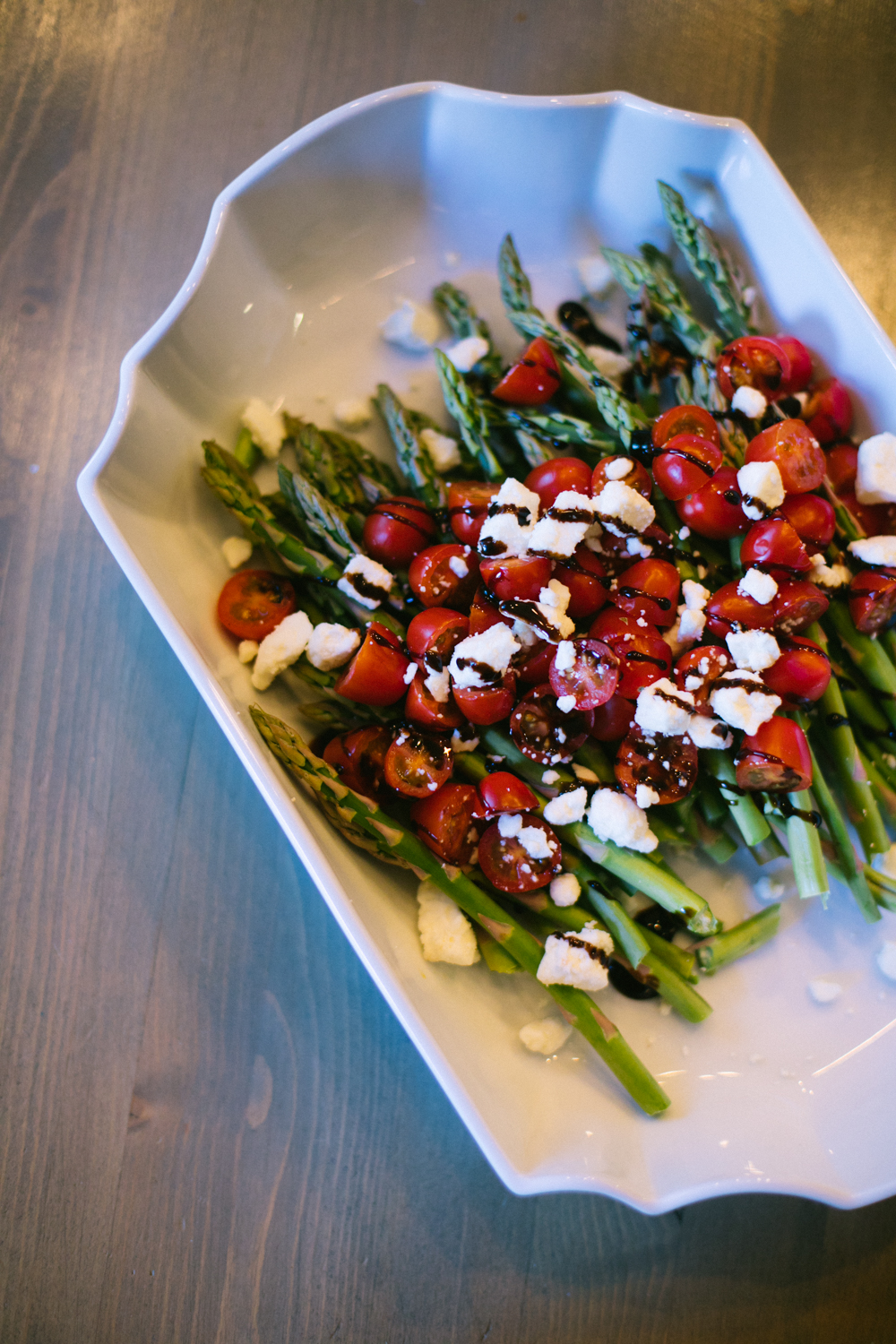 Easy & Delicious Thanksgiving Recipes featured by top Las Vegas lifestyle blog, Life of a Sister: asparagus and cherry tomatoes