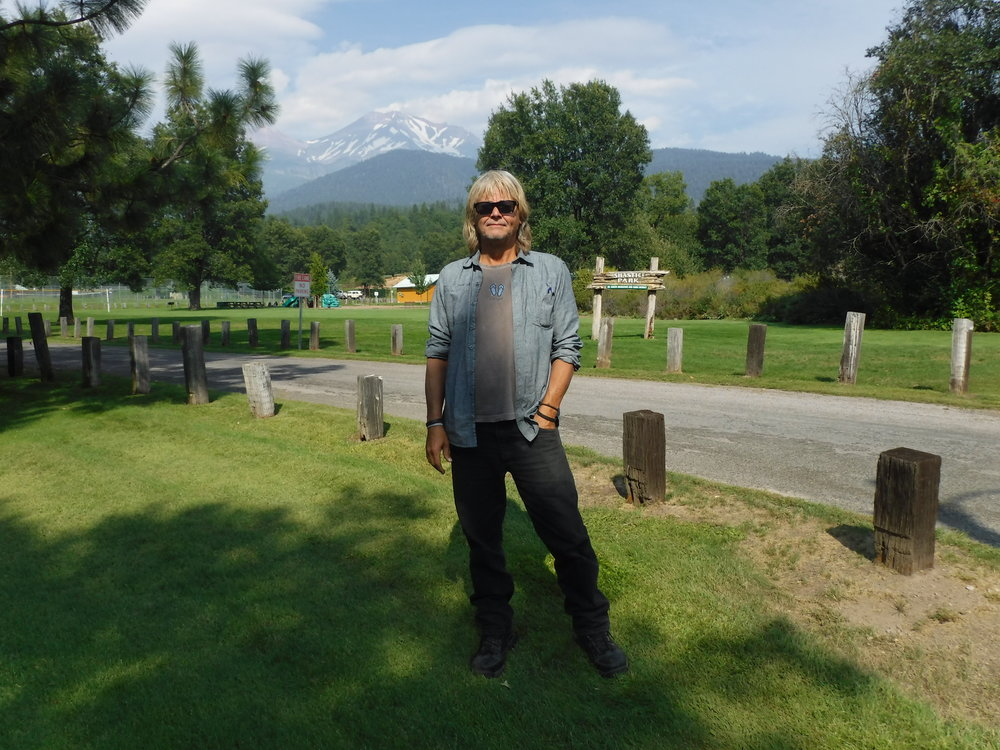 I am in Mount Shasta City - here at good ole' Mount Shastice Park. Yes there is an ice skating rink behind and to the right of me, out of sight of this picture.