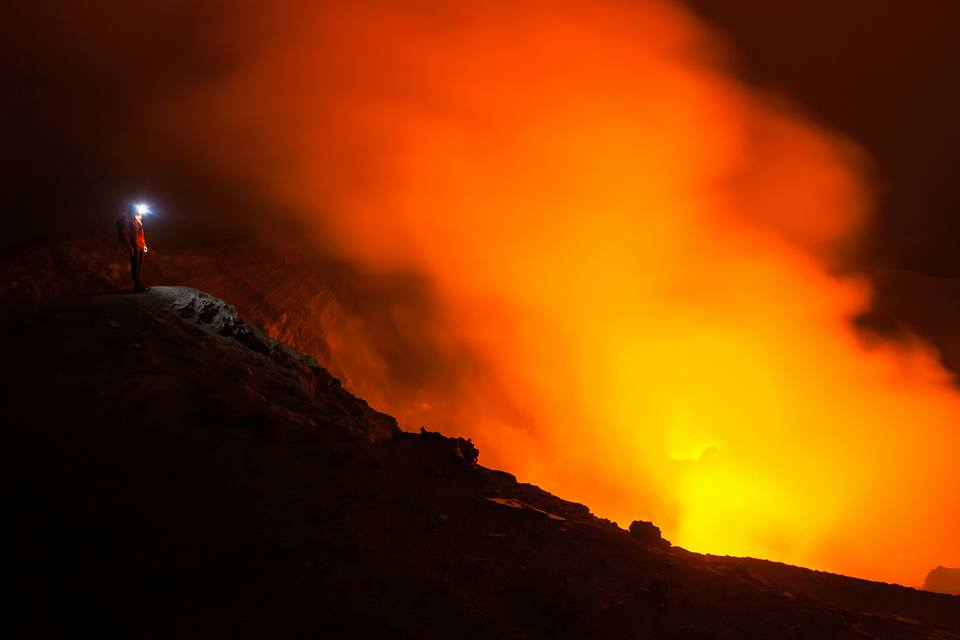 Standing on the edge of Mt Yasur. Photo credit: Joel Johnsson