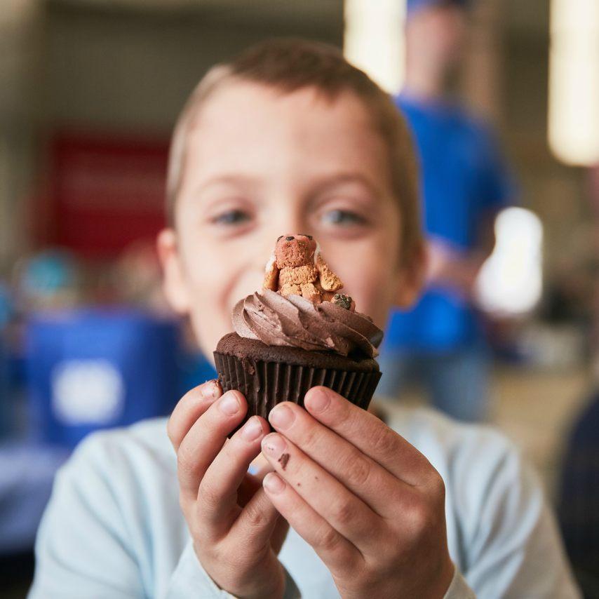 Boy holding a cupcake
