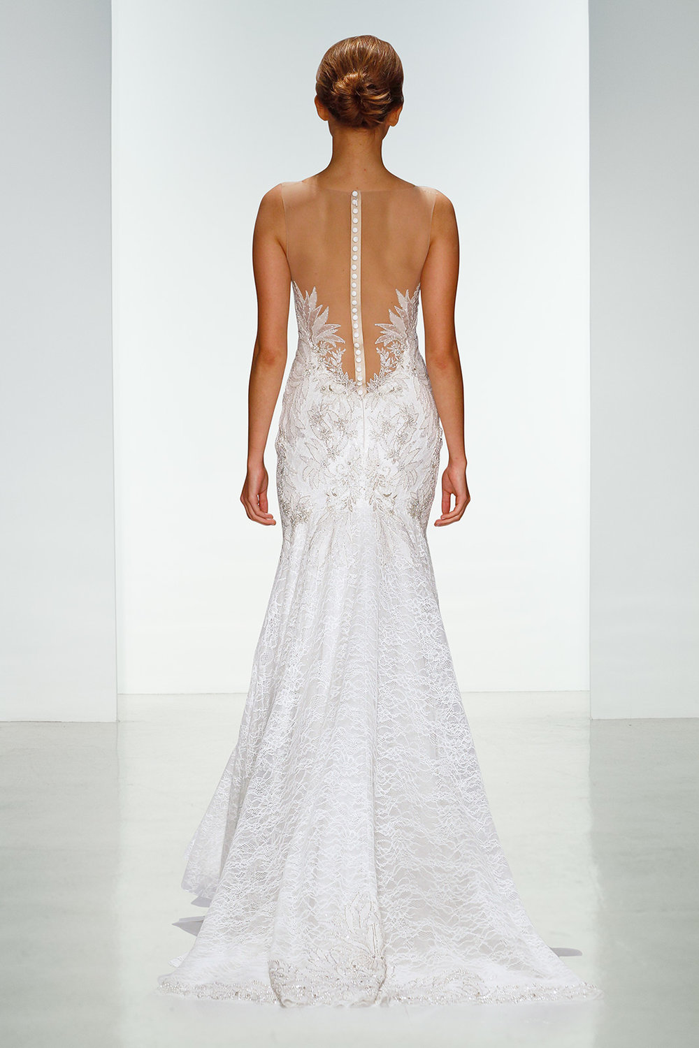 Season: Spring 2016    Gown name: Nica    Description: A strapless trumpet gown in embroidered chantilly lace.