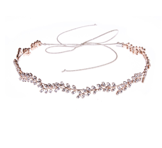 Name: DELICATE VINE CIRCLET    Description:Use this hair accessory to add a touch of romance to your outfit this season. Swarovski crystals are carefully hand-crafted into individual leaves which are then formed into a beautiful bandeaux headband with metallic ribbon ties at back. Lay this hair accessory over flowing natural hair and tie with the metallic ties at back, or cut the ties and pin into a more formal updo. All Jennifer Behr hair accessories and headbands are handmade in New York City