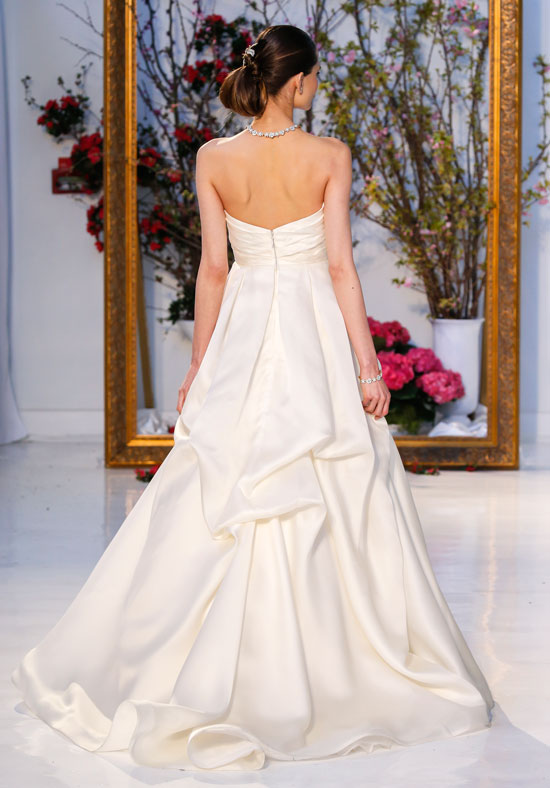 Season: Spring 2017    Gown name: Magnolia    Description: A strapless, silk satin organza gown with draped pickup skirt revealing an alençon and Chantilly lace underskirt.