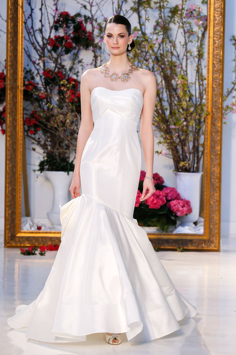 Season: Spring 2017    Gown name: Summer Sweet    Description: A strapless taffeta mermaid gown with draped bodice and corseted lace back accented by large bow.