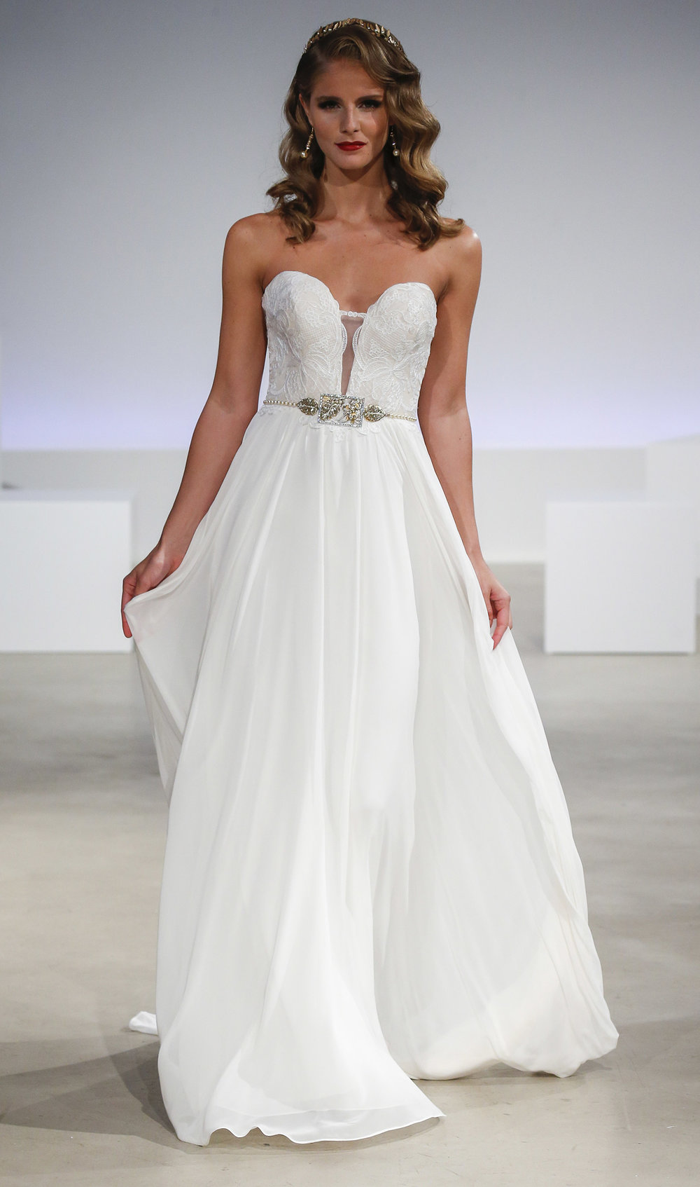 Season: Fall 2017    Gown Name: Olive    Description: A strapless bodice with plunging neckline and sheer back of embroidery with flowing chiffon skirt.