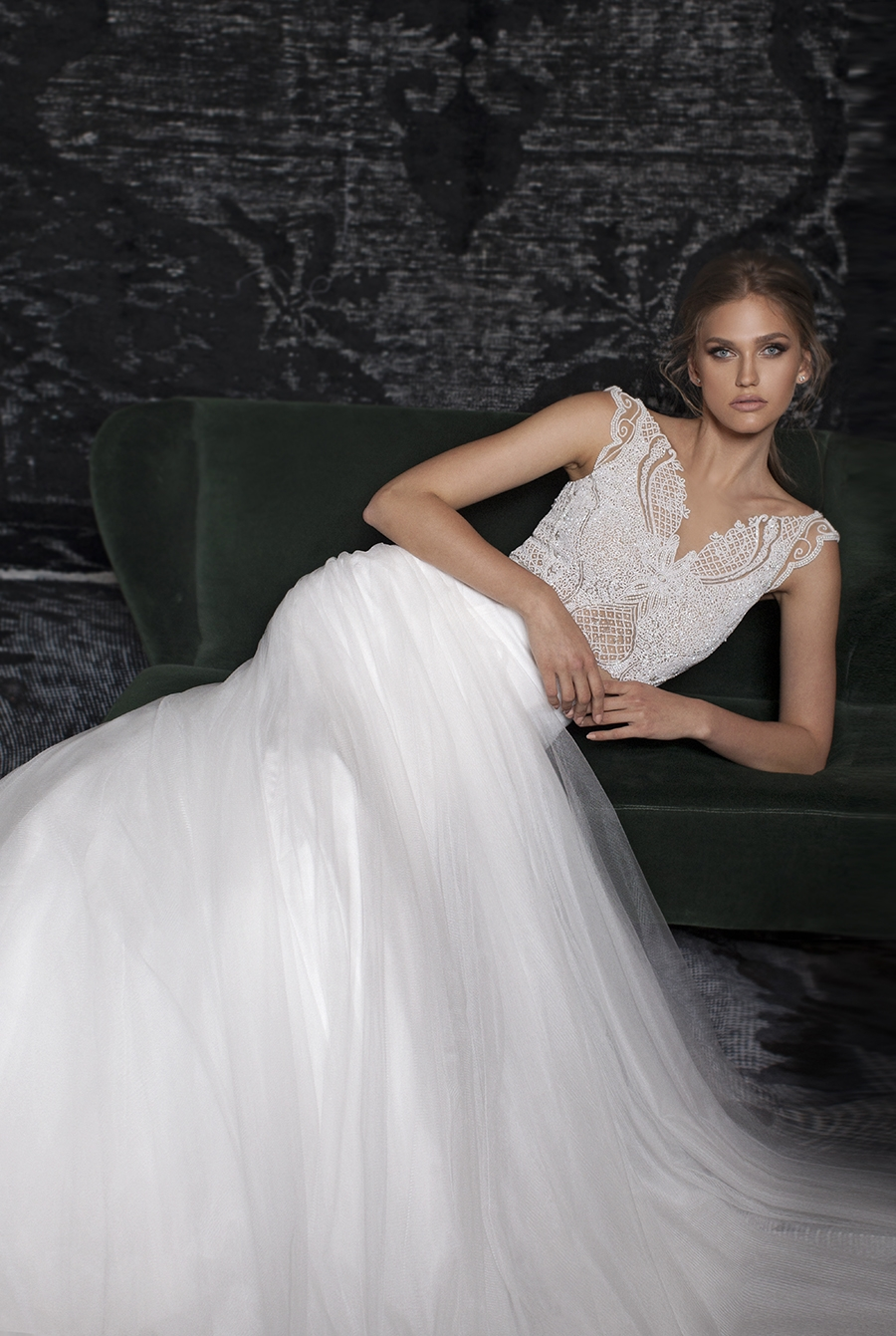 Season: Fall 2017    Gown name: Buterfly    Description: A high neck opening all hand beaded on top of nude illusion tulle base.